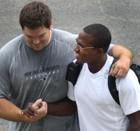 Offensive lineman Dan Connolly and wide receiver Matthew Slater get reacquainted yesterday.