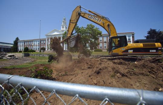 The old Norwood High is being demolished in sections. The new high school has traces of its predecessor, such as a grand entrance and clock tower.