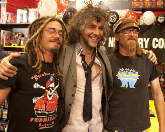Wayne Coyne (center) with Hoover brothers Brendan (left) of Everett and Nolan of Lynn at Newbury Comics.