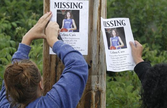 Lori McKearney and Kaylin Pettit hung up signs in Colebrook, N.H., asking for help finding Celina Cass, missing since Monday.