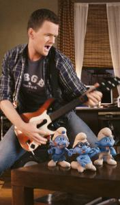 "Neil Patrick Harris plays Rock Band with Gutsy, Brainy, and Grouchy Smurf in ""The Smurfs.''"