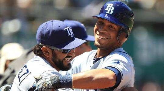 Desmond Jennings (right) celebrates with Rays teammate Sean Rodriguez after Jennings scored in the seventh inning.