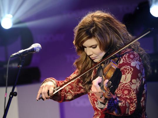 Alison Krauss (shown in April in New York) shared the spotlight Thursday night with her longtime band, Union Station.