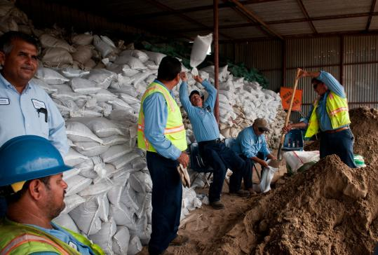 Workers in San Benito, Texas, distributed sandbags, but many Texans were looking forward to much-needed rain.