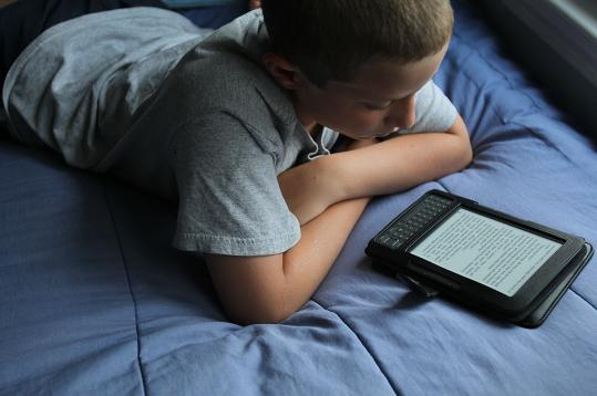 Sam Levy, 12, and his twin brother became e-reader users this summer after seeing how much their sister Emma enjoyed hers.
