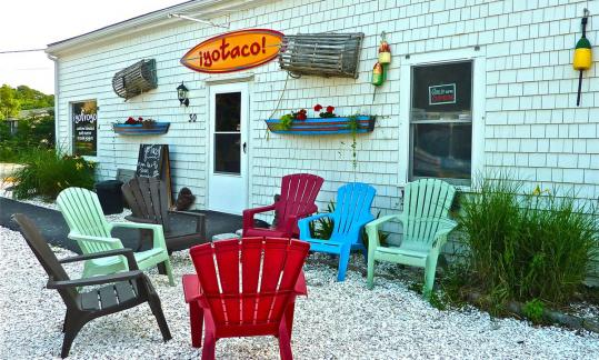 The chairs outside yoTaco are great spots for enjoying Tex-Mex favorites, such as the fish taco below.