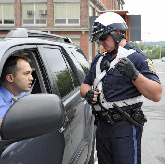 An officer issued a warning in Fitchburg, where citations have dropped 19 percent.