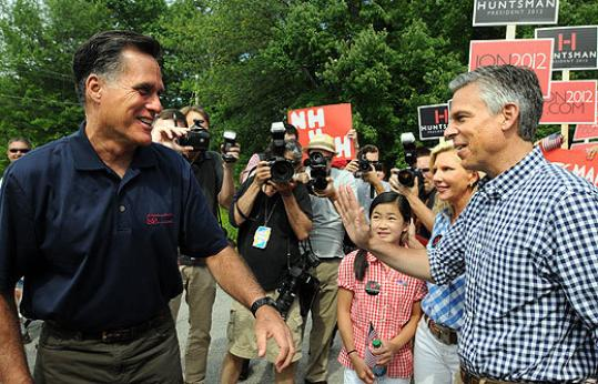 Mitt Romney (left) and Jon Huntsman, in New Hampshire on July 4 , are both GOP presidential candidates and Mormons.