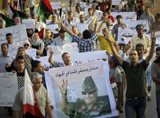 Libyans rallied in Benghazi yesterday in the name of a rebel military leader who was mysteriously killed last week.