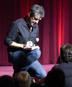 Craig Ferguson signs a copy of his book for a fan at the Wilbur.