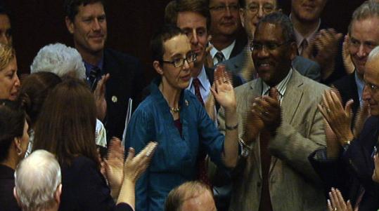 Colleagues applauded Representative Gabrielle Giffords, making her first appearance since being shot in the head in Arizona in January.