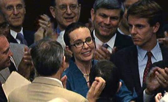 Representative Gabrielle Giffords is greeted on the floor of the House of Representatives Monday.