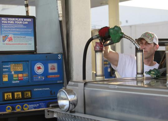 A driver filled up his gas and diesel tanks at a Mobil gas station in Los Angeles. Exxon Mobil is one of four companies with AAA credit ratings. The others are Automatic Data Processing, Johnson & Johnson, and Microsoft.