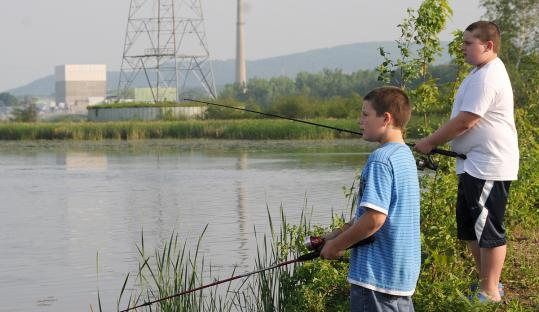 Two youngsters went fishing in the Connecticut River across from the Vermont Yankee nuclear plant.