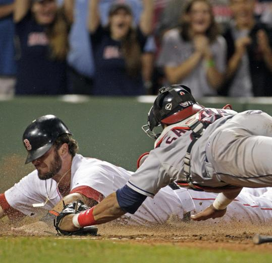 It took an all-out effort by Jarrod Saltalamacchia to slide around the tag of catcher Carlos Santana to win it in the ninth.