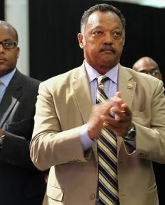 Rev. Jesse Jackson applauds Rev. Al Sharpton Thursday at the National Urban League&#8217;s convention in Boston.