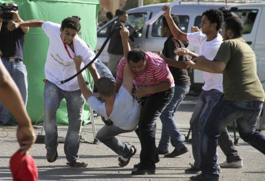 Supporters of Hosni Mubarak, the former president of Egypt, clashed with the opposition yesterday outside the courtroom.