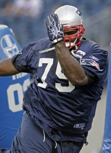 Patriot Vince Wilfork swims past a tackling dummy at practice last night.