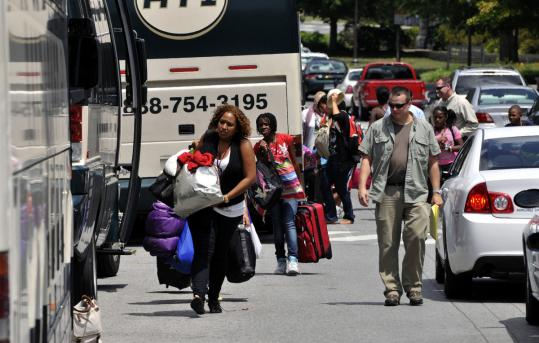 Summer camp counselors and youngsters boarded buses headed home to Washington, D.C., yesterday after a five-hour lockdown at Virginia Tech because of a reported gunman.