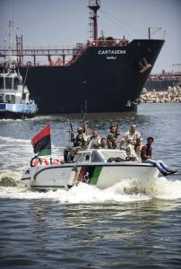 Libyan rebels escorted the oil tanker Cartagena into a port yesterday. Libya has struggled with fuel supplies.