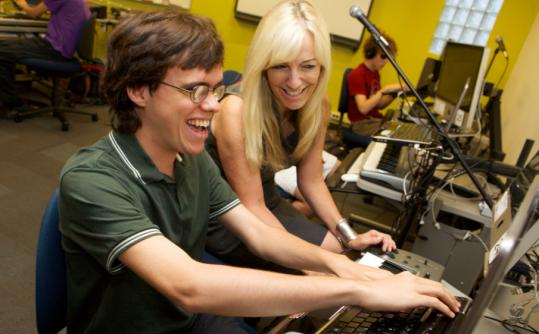 Lisa Hilton with student Noe Socha in the adaptive music lab at Berklee.