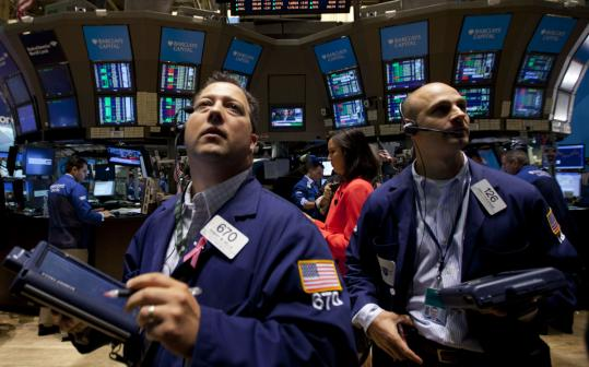 Traders were busy on the floor of the New York Stock Exchange yesterday, as stocks rallied briefly on word that hiring improved in July.