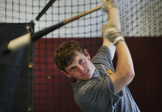 Dave Kussell (above) and Jake Levine work on their swings in the batting cage at the New England Ruffnecks facility in Needham. The nine-year-old organization is designed to prepare players for the rigors of college baseball.