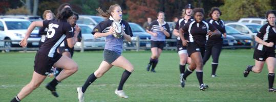 Milton's Katie O'Malley (with ball) has become a rugby standout at Stonehill College.
