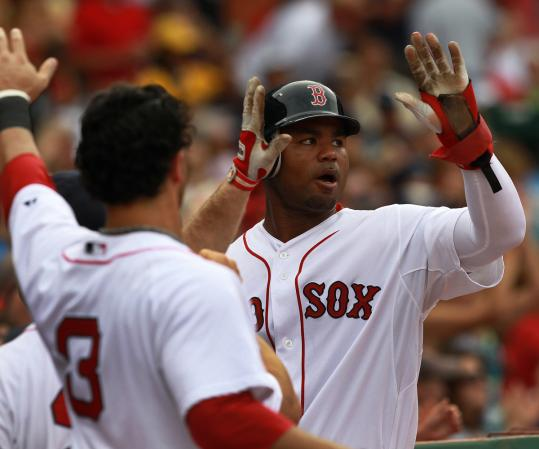 Carl Crawford returns to a happy Red Sox dugout after scoring the first run of the game in the third inning.