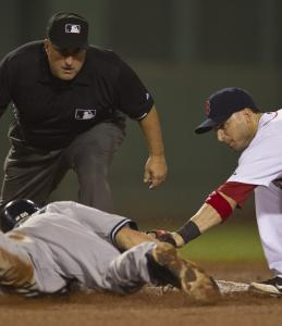 Marco Scutaro applies the tag at second to Yankee Russell Martin who tried to stretch a single into a double in the fifth inning.