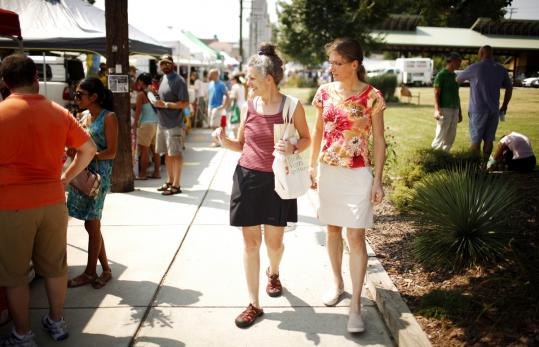 Diane Daniel (left) and her wife, Lina, shop at the farmers' market in Durham, N.C., last month.