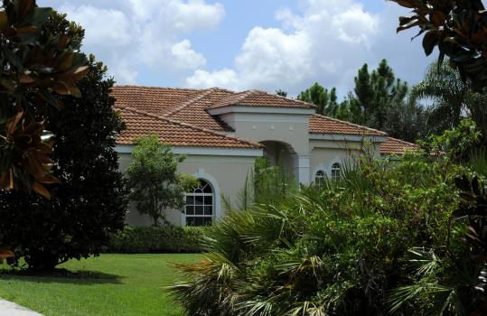 This $450,000 house in Bradenton, Fla., photographed Aug. 5, is one of John Barranco's luxury vacation homes.