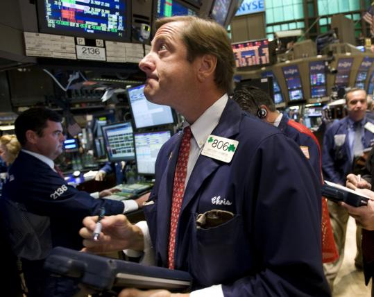 Stocks have been sinking for more than a month. The S&P 500 has lost 17 percent of its value since early July. Above, the floor of the New York Stock Exchange yesterday.