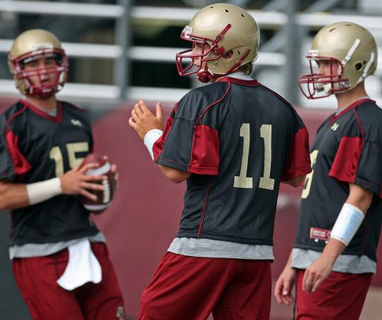 Chase Rettig (11) is No. 1 on the depth chart over Dave Shinskie (left) and Mike Marscovetra.