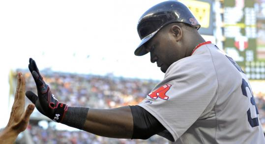 David Ortiz contributed four hits - including a two-run homer during a four-run sixth - in the Sox' third straight win. He also drove in the winning run in the ninth.