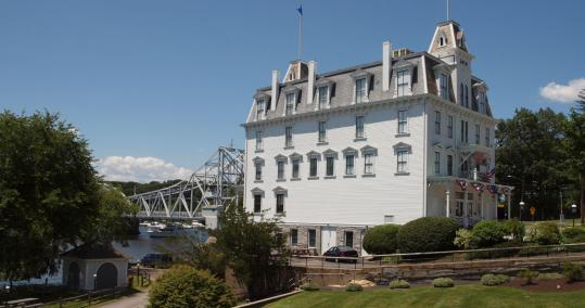 "The Goodspeed Opera House in East Haddam, Conn., with the town's nearly 100-year-old ""swing bridge'' over the Connecticut River behind it."