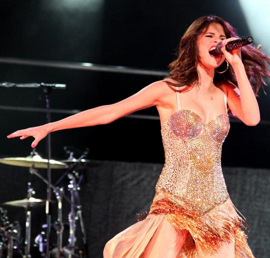 Live Nation is bringing Selena Gomez to Boston Aug. 25. It says ending mass discounting to fill seats has improved profits.
