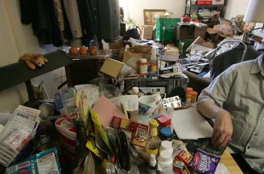 The typical hoarder is male, living alone, and in his 50s, according to statistics cited by an Arlington official.