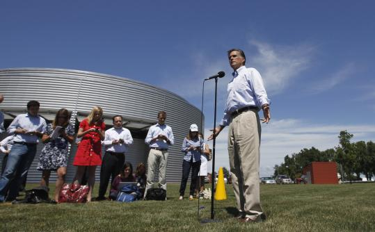 Mitt Romney answered questions from reporters yesterday in Pella, Iowa, where he took part in a business round-table.