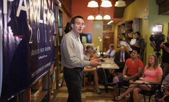 Tim Pawlenty, in Adel, Iowa, yesterday, has said his national themes are consistent with his career-long conservatism. Of the harsh tone some find uncharacteristic, he said: ''The country's sinking and I'm not only concerned, I'm angry, mostly at Obama.''
