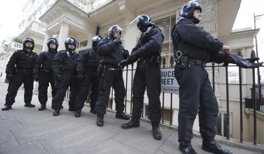 Police officers raided a part of Pimlico, London yesterday. Authorities are considering curfews.