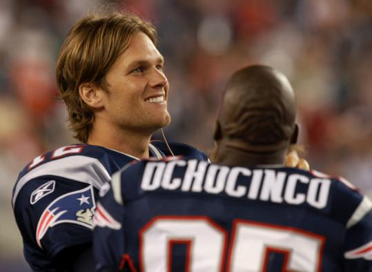 Patriots quarterback Tom Brady and receiver Chad Ochocinco manned the sideline last night.