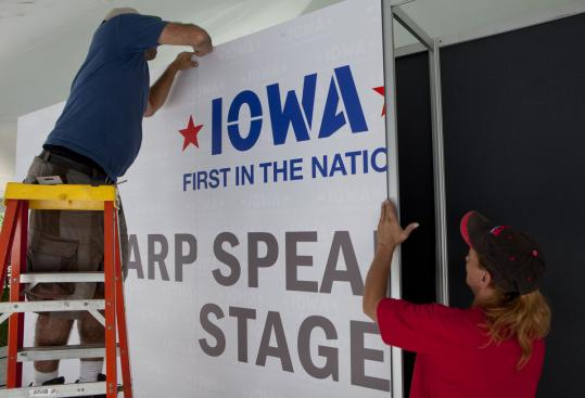 Workers prepared yesterday for the Republican presidential straw poll today in Iowa. Seven of nine candidates are participating.