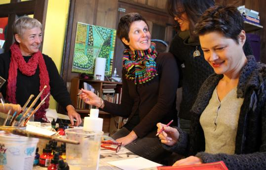 Artists (from left) Lucy Arrington, Lynn Waskelis, Adrienne Wetmore, and Lola Baltzell at work in Baltzell's East Boston studio.