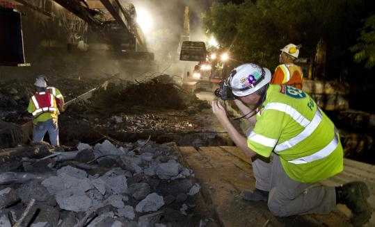 Stephen SetteDucati takes a picture under the Mystic River Crossing northbound section of Interstate 93 last month as the bridge is torn down.