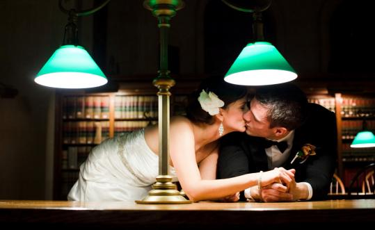 Newlyweds Joanna and Dean Howarth kissed in Bates Hall at the Boston Public Library.