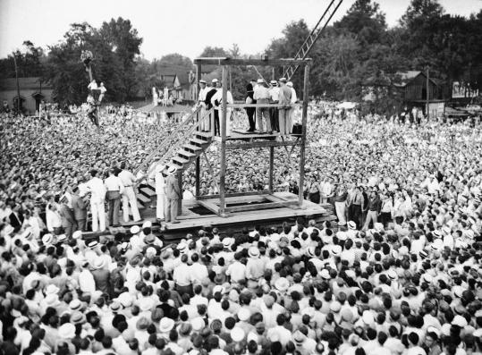 A crowd watched as a black hood was placed on Rainey Bethea's head before his hanging on Aug. 14, 1936. In 1938, Kentucky ended public executions - the last state to do so.