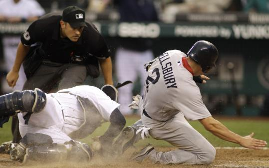 Mariners catcher Josh Bard came out of the rubble by tagging out Jacoby Ellsbury at home in the fourth inning. Sox manager Terry Francona kicked up a storm and was ejected after umpire Mark Ripperger called Ellsbury safe, then changed his ruling.