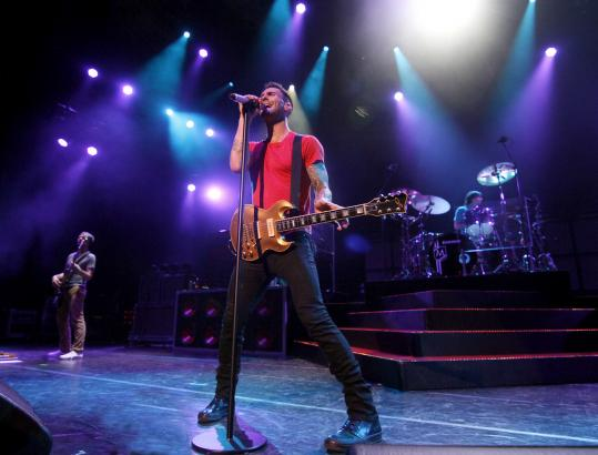 Vocalist-guitarist Adam Levine (center) leads Maroon 5 on Saturday at Comcast Center.