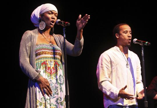 Dominique Ashaheed (left) and Ayinde Russell of Slam Nuba, the winning poetry slam team.